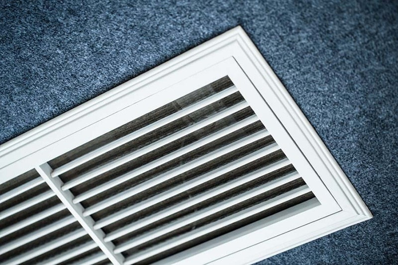 air conditioning definitions, close up shot of the vents of an ac