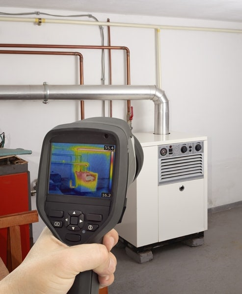 Service Check of Gas Furnace with Thermal Camera. Fall HVAC Mainteance.