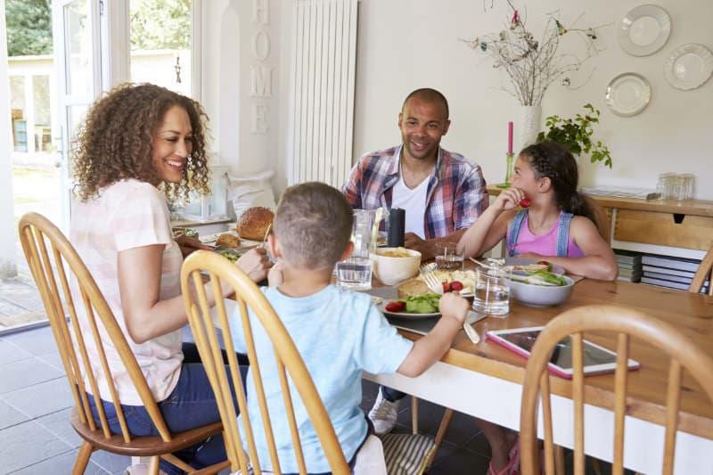 Happy Family Sitting Around Table