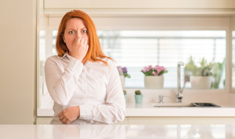 Woman Smelling Odor In Her Home
